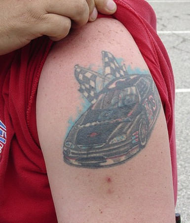 Black Racing Car With Flags Tattoo On upper Arm