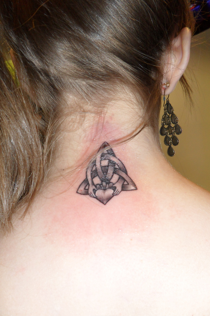Celtic Knot With Hands Tattoo On Back Neck