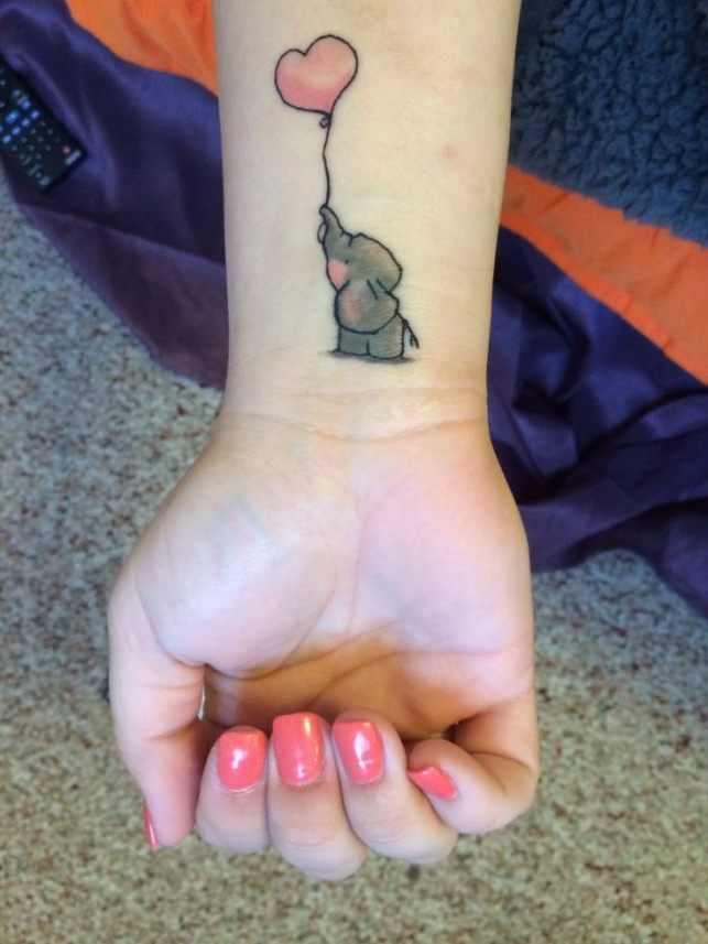 Grey Ink Small Elephant Baby With Pink Heart Tattoo On Wrist