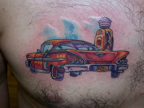 Red Car On petrol filling Station Tattoo On Chest