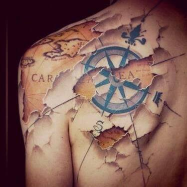 Ripped Skin Compass Nautical Tattoo On back
