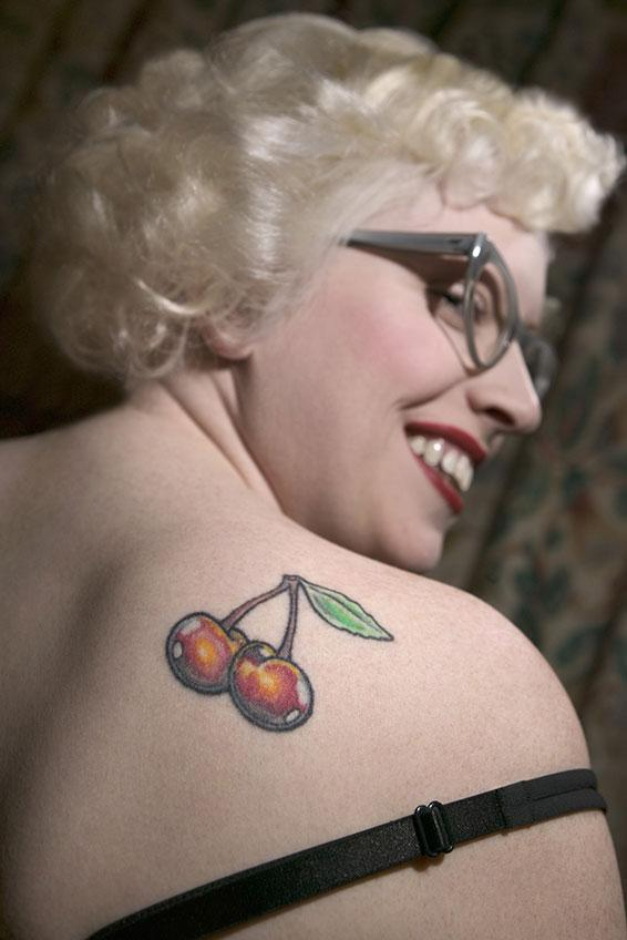 Woman With Cherry Tattoo On Back Shoulder
