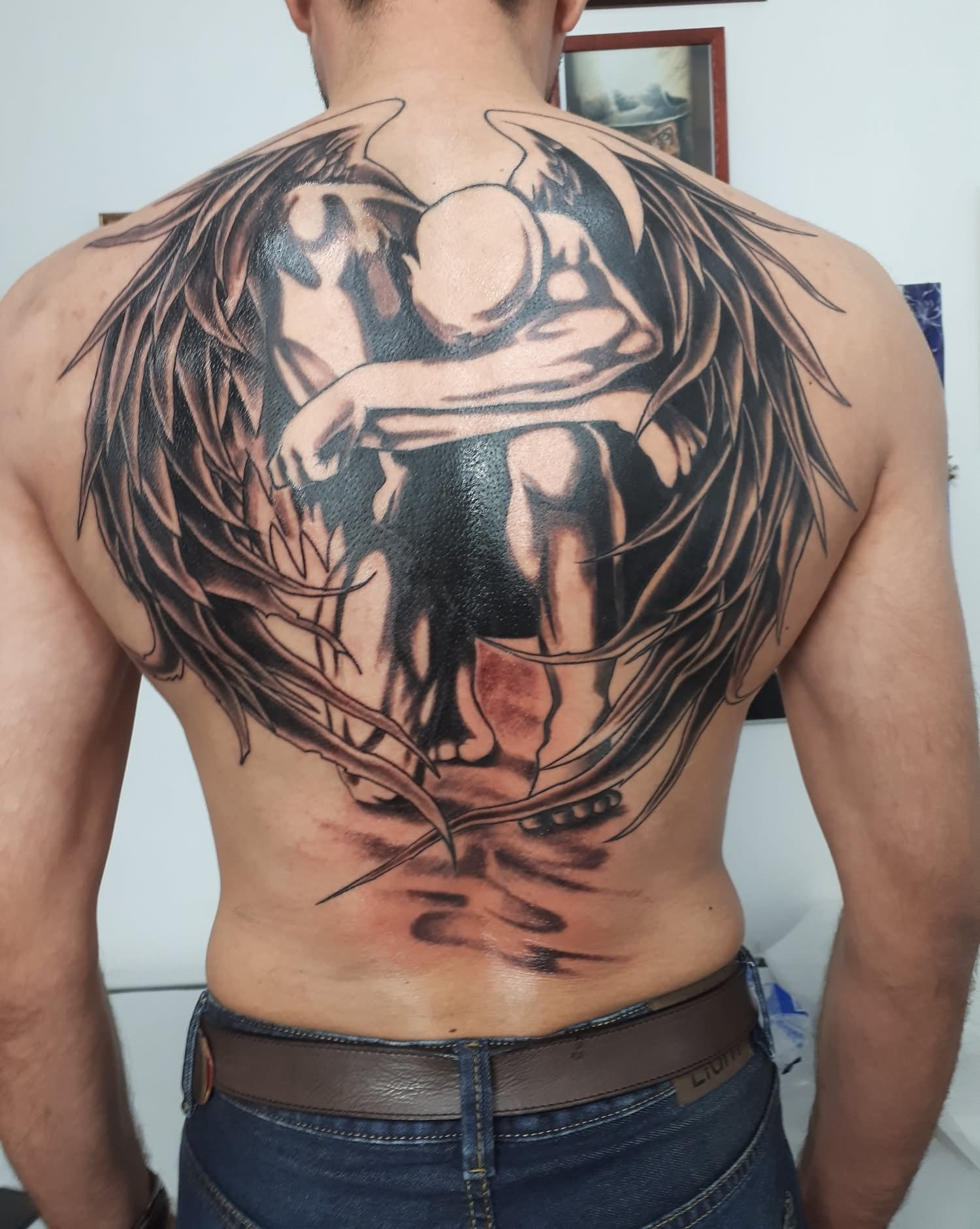 Fallen angel tattoo on back