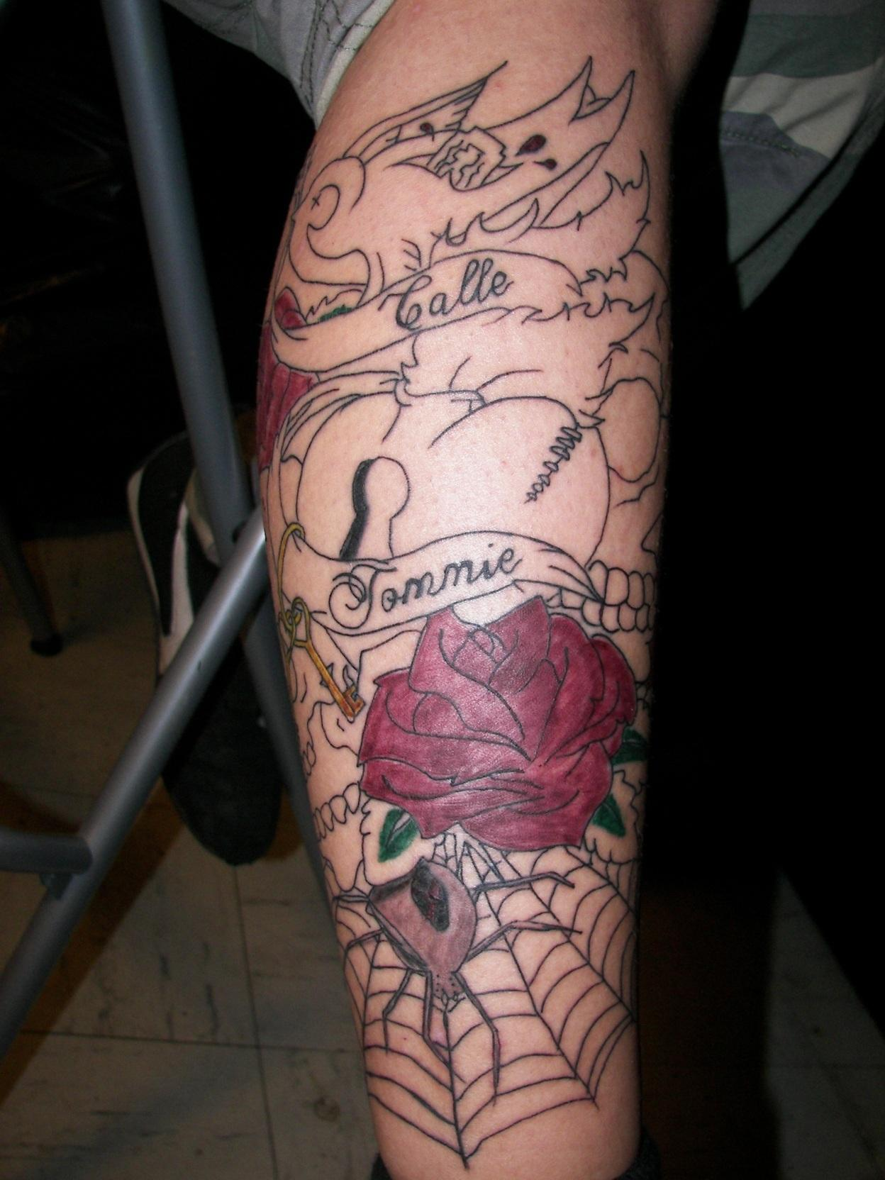 Red Rose Flower And Spider Web Leg Tattoo
