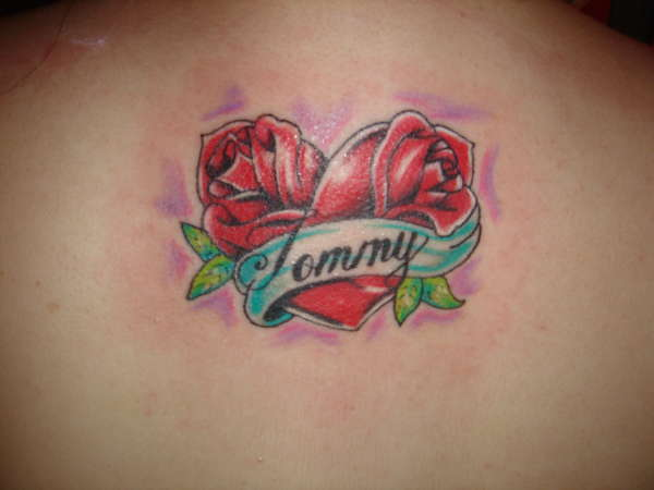 Tommy Banner And Heart Tattoo