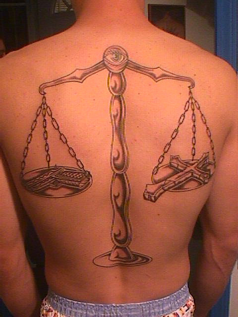 grey ink balance justice tattoo on back body